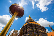 Old Golden Pagoda With Umbrella Of Wat Phrathat Lampang Luang.