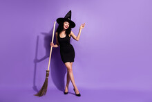 Full Size Photo Of Optimistic Nice Brunette Lady Stand With Broom Wear Black Dress Shoes Cap Isolated On Lilac Background