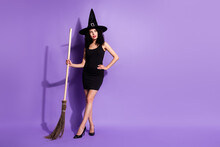 Full Size Photo Of Optimistic Nice Brunette Lady Stand Look Empty Space With Broom Wear Black Dress Shoes Cap Isolated On Lilac Background