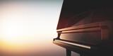 Grand piano keyboard on sunset sky