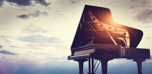 Grand Piano On Sunset Sky Background