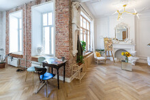 Bright Workshop Room For The Creation And Work Of An Architect And Artist In A Loft Style With Brick Walls And Parquet. The Walls Are Decorated With Examples Of Stucco.