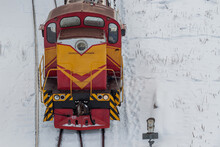 Diesel Shunting Locomotive At A Snow-covered Railway Station. The Concept Of Railway Transportation.
