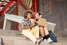 Multiethnic Female Friends, Working With Computer Outdoors, Telecommuting