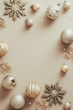 Fototapeta Kawa jest smaczna - Elegant Christmas balls and decorations on beige background. Fashion Xmas poster design, vertical banner mockup. Flat lay, top view, copy space.