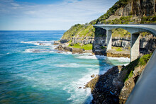 View Along Sea Cliff Bridge, Sydney South Coast. New South Wales Australia. Road Against Ocean, Cliff And Sky. No People.
