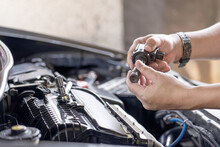 Close Up Hand Asia Technician Check Old Spark Plug Coil In Maintenance Service Of Gasoline  Engine In Garage