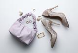 Fototapeta Kawa jest smaczna - Stylish woman's bag, shoes and bijouterie on light background, flat lay
