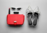 Fototapeta Kawa jest smaczna - Flat lay composition with stylish woman's bag on light background