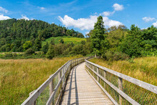 Lower Lake Boardwalk Through Wetland In Glendalough, Wicklow National Park, Ireland, With A Spectacular View Over The Valley.