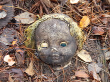 The Old Doll Head Lies On The Ground