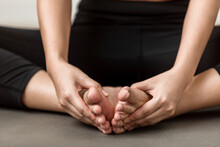 Close Up Of Young Women Practicing Yoga At Home With Baddha Konasana Butterfly Pose, Working Out, Wellness Concept