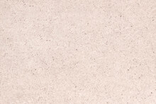 A Sheet Of Hardboard Covered With Small Dots, Scratches And Inclusions. Cardboard Mottled Heterogeneous Texture.