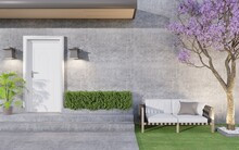 The Front Door Outside Is Made Of White Wood With Hanging Lights. In Front Of The House Are Bushes And Large Trees With Purple Flowers And Chairs To Sit In The Wind.3d Rendering