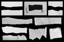 Set Of Ripped Paper Isolated On Black Background.
