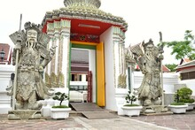 Lan Than Or Rock Giants With Weapons Represent Noble Warriors And Phra Maha Stupa Or Phra Prang In Wat Pho Also Spelled Wat Po, Is A Buddhist Temple In Bangkok, Thailand.