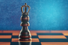 Pawn In Crown On Chess Board Against Blue Background With Copy Space. Personal Growth And Development Concept