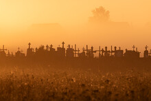 Silhouettes Of The Crosses Of The Catholic Cemetery In The Early Morning At Sunrise. Place For Your Text.