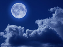 A Full Moon In A Tragic Night Sky With Clouds. A Halloween Scene With A Copy Of The Space.
