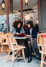 Two Women In Cafe