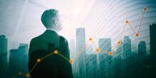 Businessman Looking At Increasing Finance Graph