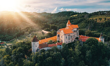 Beautiful Scenic Aerial View Of Historical Medieval Pernstejn Castle In Sunset, Czech Republic