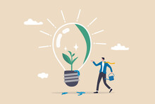 Ecology And Sustainable Business, Green Idea Or Protection Against World Climate Change, Environmental Care Concept, Smart Businessman Watering Seedling Sprout Growing Inside Green Lightbulb Idea.