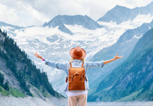 The Traveler Enjoys The View Of The Mountain Valley.. Travel And Active Life Concept. Adventure And Travel In The Mountains Region In The Austria