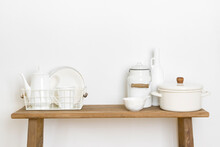 Home Decor Concept With Kitchen Utensils And Dishware On Table
