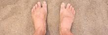 Male Bare Feet On Hot Beach Sand Closeup