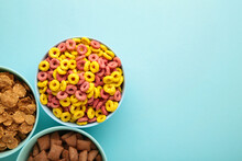 Variety Of Cereals In Blue Bowls, Quick Breakfast On Blue Background. Vertical Photo