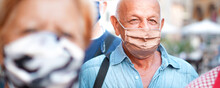 Crowd Of People Walking Down The City Streets With Face Mask On - Camera Focusing An Old Man - New Lifestyle