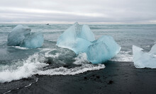 Blocks Of Glacial Ice Washed Ashore At Diamond Beach, Iceland