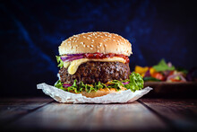 Cheese Burger With Lettuce, Tomato And Onion