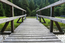 A Wooden Pier Over The Lake In The Forest.