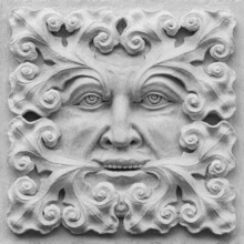A Stone Carving Of A Green Man. Decorative Architectural Ornament.