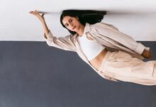 Graceful Woman Dancing Near Wall In Street