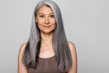 Grey Haired Asian Woman In Bra Looking At Camera Isolated On Grey
