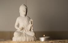 A Candle Accompanying The Buddha Meditation