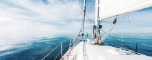 White Sloop Rigged Yacht Sailing In An Open Baltic Sea On A Clear Sunny Day. A View From The Deck To The Bow, Mast And Sails. Estonia