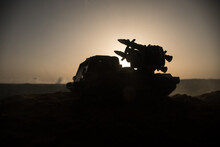 War Concept. Battle Scene With Rocket Launcher Aimed At Gloomy Sky At Sunset Time. Rocket Vehicle Ready To AttacSelective Focus