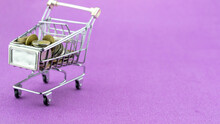 Shopping Cart With Coin On Purple Paper Background Conceptual Of Stop Motion Thai Bath Coin In Cart For Shopping Concept Business