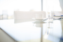 Coffee Cups And Water Glasses On Meeting Table