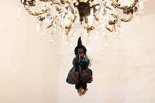Halloween Party Decorations. Preparation For The Holiday. Witch On A Chandelier