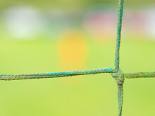 Close-up Knot Of Blue Net Around Small Soccer Field