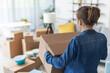 Leinwandbild Motiv Woman carrying boxes in her new home