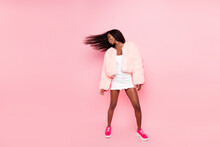 Full Length Photo Of Charming Positive Dark Skin Girl Toothy Smile Flying Hair Isolated On Pink Color Background