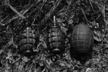 Vintage Grenades On The Ground In Black And White
