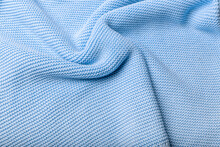 Turquoise Knitted Fabric Background. Purl Loops Close-up. Crumpled Curved Surface. Copy Space