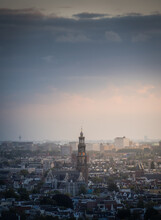 Aerial View Of The City Of Amsterdam, Capital Of The Netherlands On A Calm Summer Evening, During Cloudy Sunset